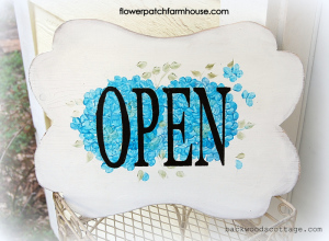 blue hand painted open closed sign