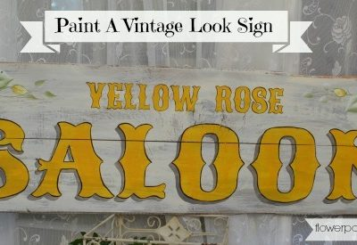 Paint up a DIY vintage saloon sign with yellow roses. Step by step instructions to make it super simple.