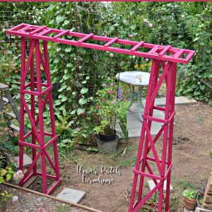DIY garden arbor made from obelisks, with text overlay, DIY Garden arbor, easy to build and budget friendly, Flower Patch Farmhouse