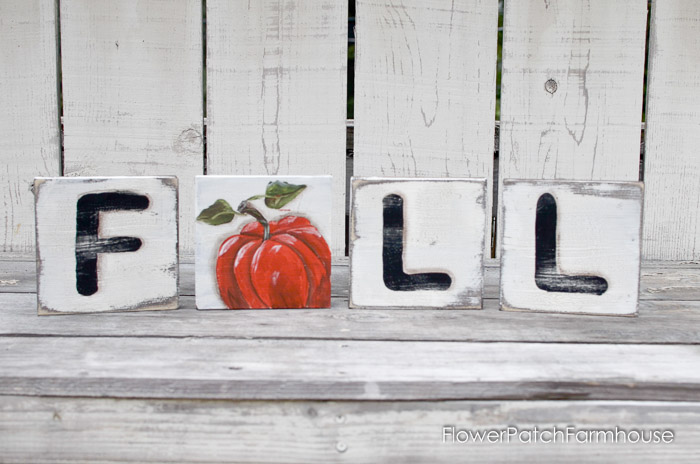 Make your own fabulously fun Scrabble Tile art. Instead of an A you have a handpainted pumpkin on one side and an Autumn leaf on the other. Easy to make! FlowerPatchFarmhouse.com