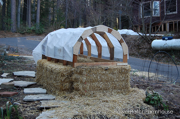 Straw bale garden hot bed, great for starting heat loving plants earlier in the season for more produce all summer long. FlowerPatchfarmhouse.com