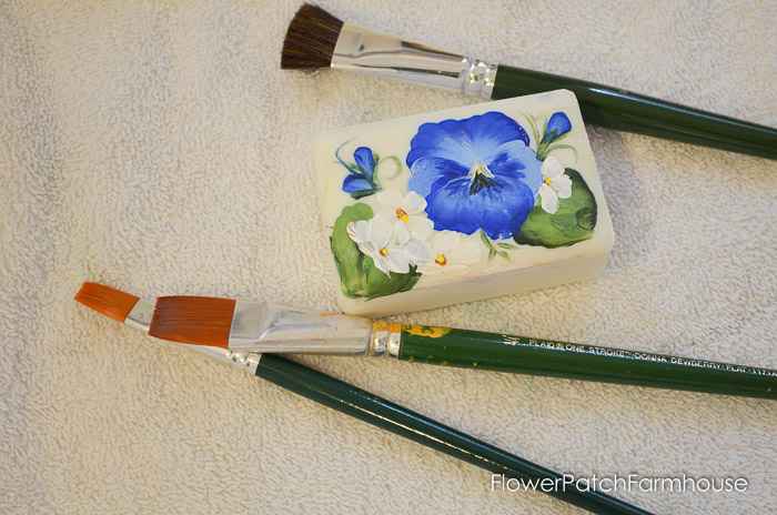 Paint a Pansy on a Bar of Soap, How to Paint Flowers on Bars of Soap. Great DIY gifts, decor and just plain fun! Create beautiful miniature paintings on soap with craft paints.