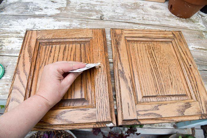 Filling hold with wood filler in cabinet door, DIY frames from cabinet doors.