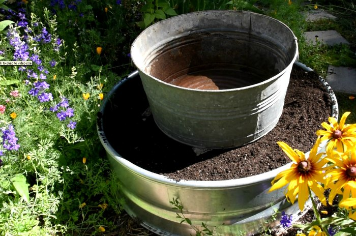 galvanized tub on top of soil filled fire ring