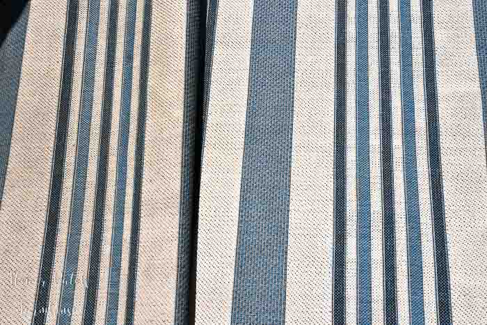 close up of outdoor rug, blue stripe