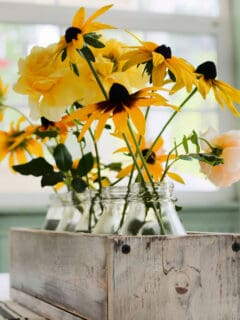 Fall flowers in a diy rustic crate on table