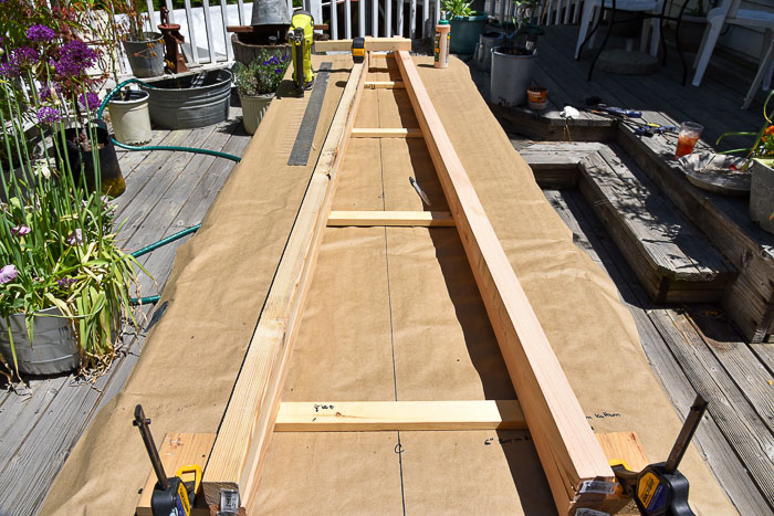 lumber laid out to build DIY obelisk tomato support