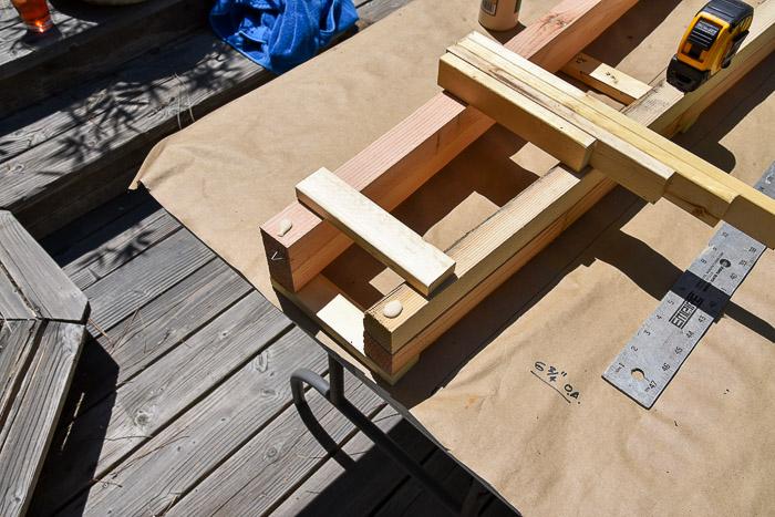Add a dot of wood glue before nailing