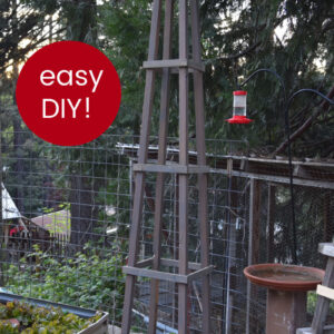 DIY tomato cage in garden with text overlay, practical meets pretty, easy DIY tomato cage, FlowerPatchFarmhouse.com