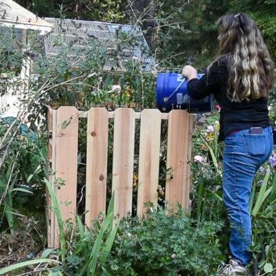 filling DIY compost bin